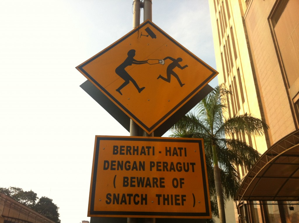 Beware of the infamous SNATCH THIEF! Not the most welcoming sign.