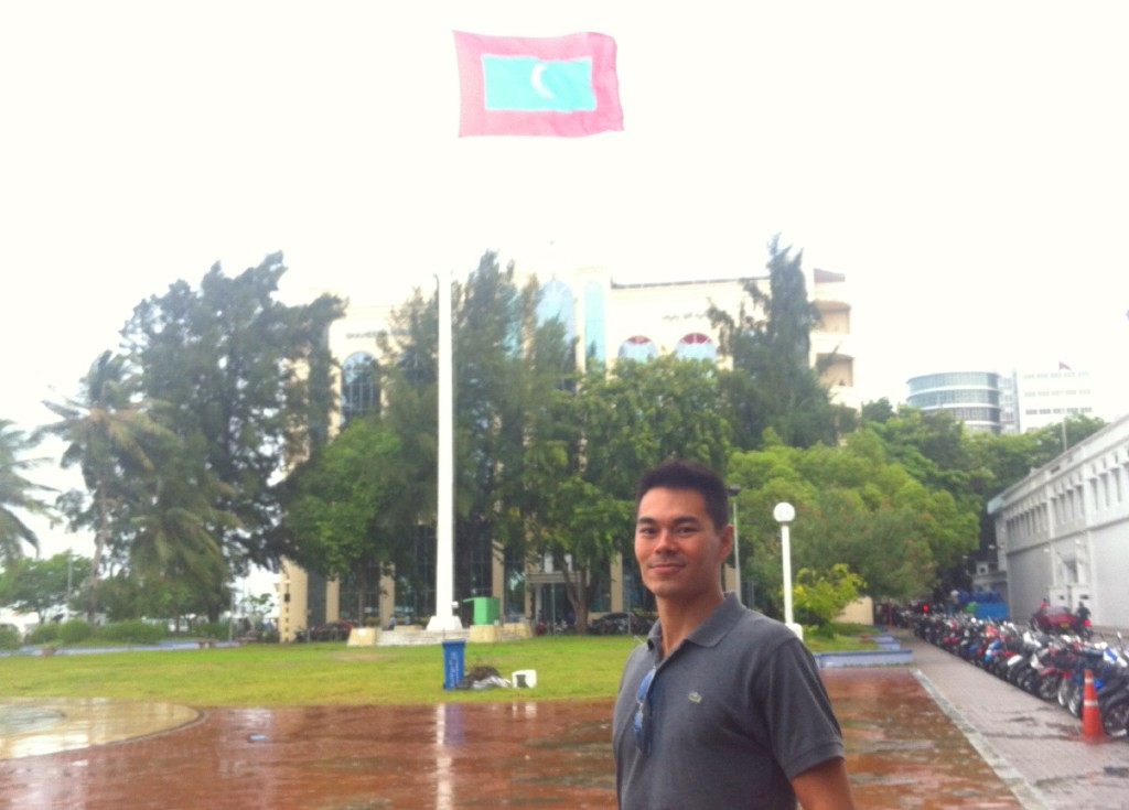 Rainy <strong>Republic Square</strong> and the flag of the Maldives.