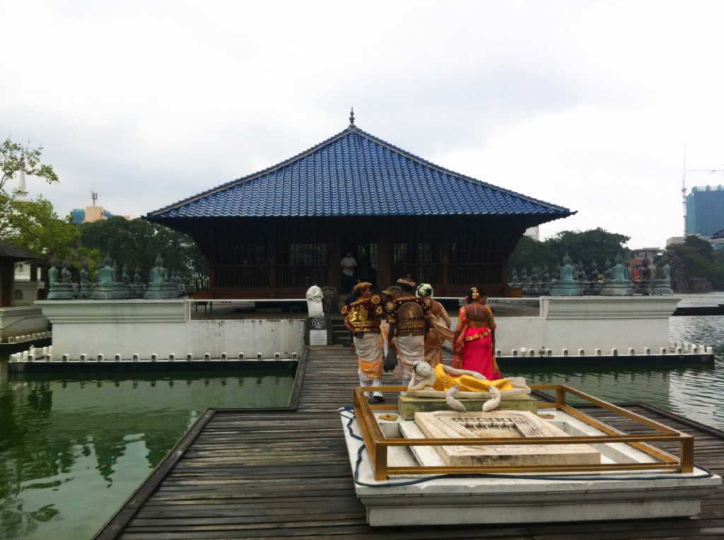 A couple in traditional dress for wedding pictures at the Seema Malakaya shrine.