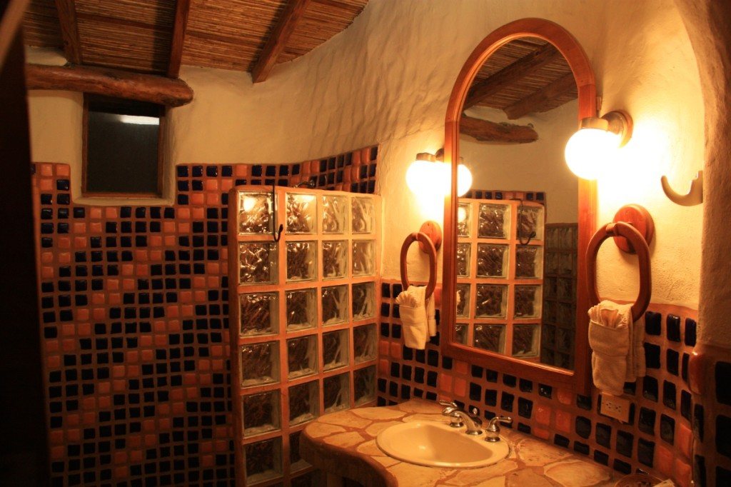 Large tiled shower and sink area.