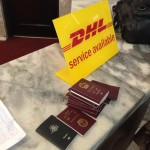 Surrendering our passports and, surprise, DHL delivers!